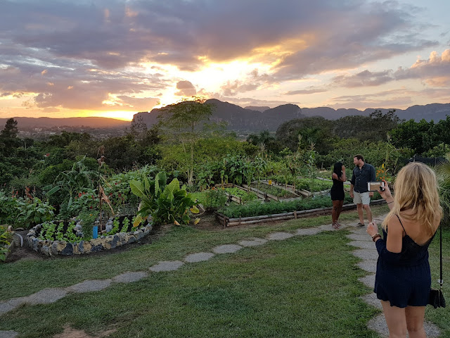 Tourists taking photos of the sunset over a farm in Vinales, Cuba