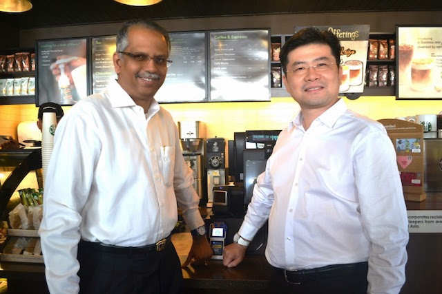Maybank Group Head of Cards & Wealth, Mr. B Ravintharan and Mr. Ng Kong Boon, Visa Country Manager for Malaysia giving it a go