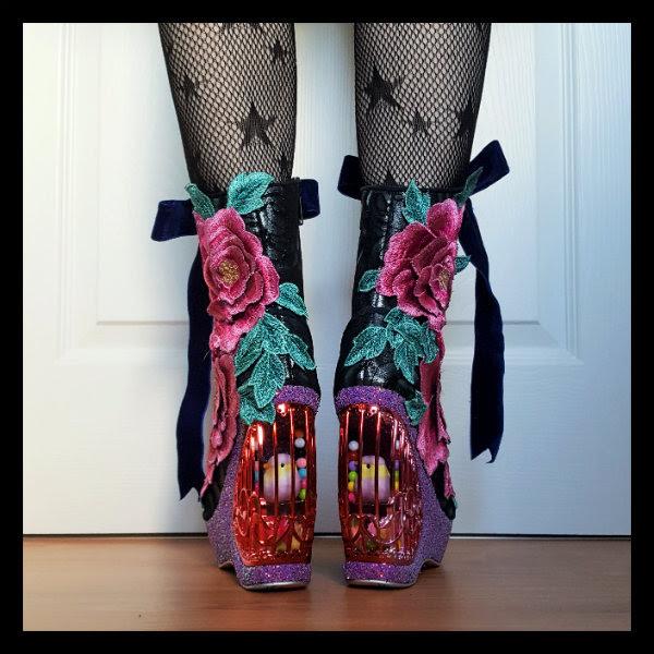 wearing Irregular Choice Maya boots showing birdcage heel detail from behind