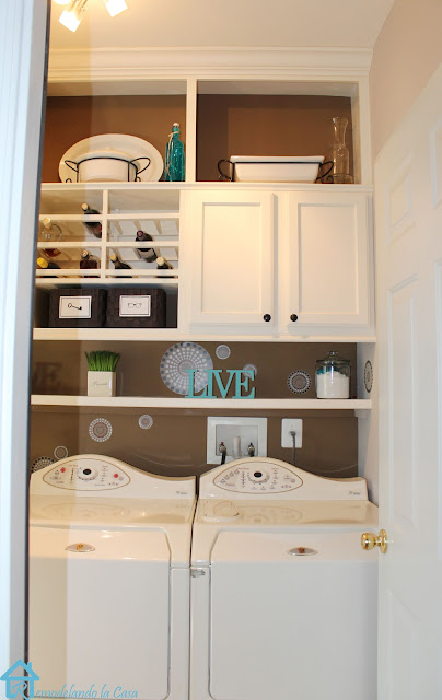 maytag machines in laundry room with built-ins in brown