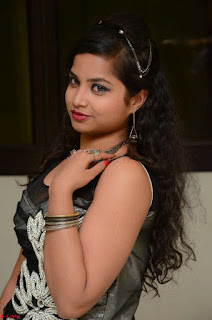 Shrisha Dasari in Sleeveless Short Black Dress At Follow Follow U Audio Launch 041.JPG