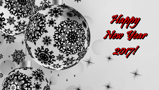 A picture of baubles with a 'happy new year' inscripition.