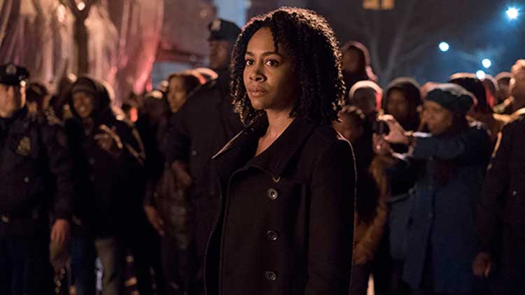 Simone Missick holds back the crowds as Misty Knight in Luke Cage.
