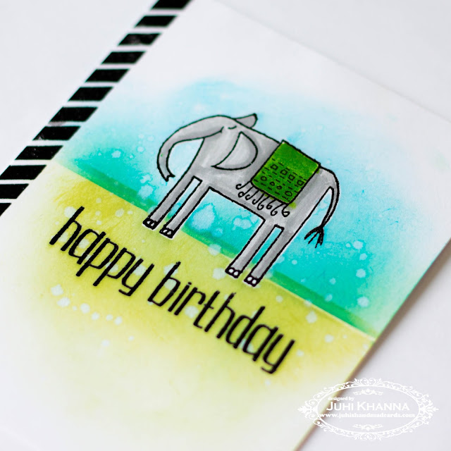 Close up of one layered card with masking, partial stamping and ink blending using stamps from Happy Little Stampers