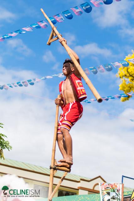 kaamulan festival stilt performer