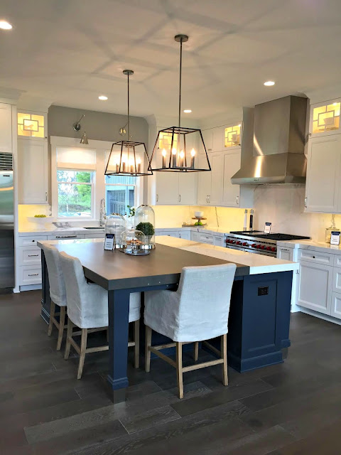 dark blue island white cabinets