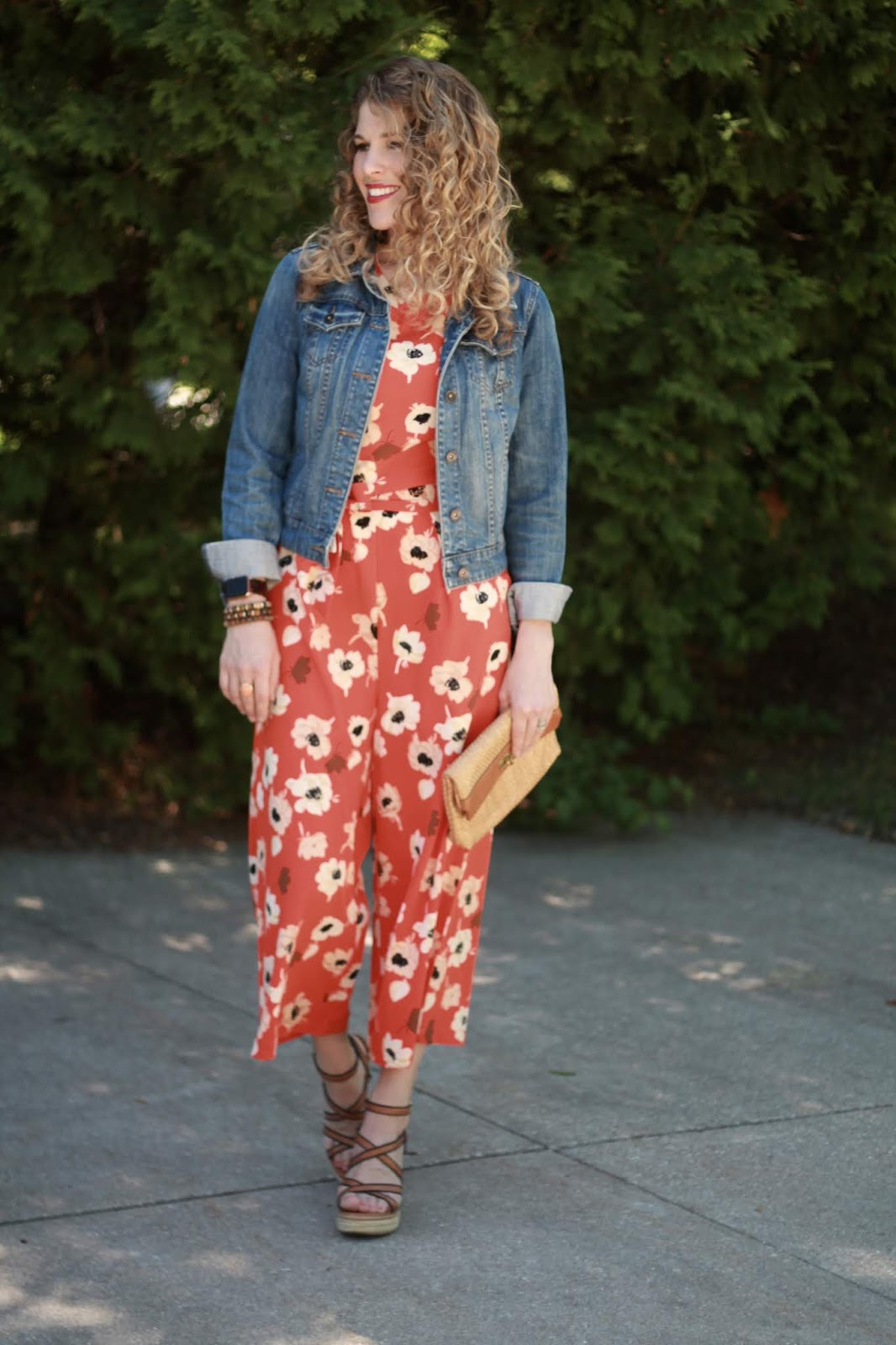 orange floral jumpsuit, denim jacket, wedge sandals,