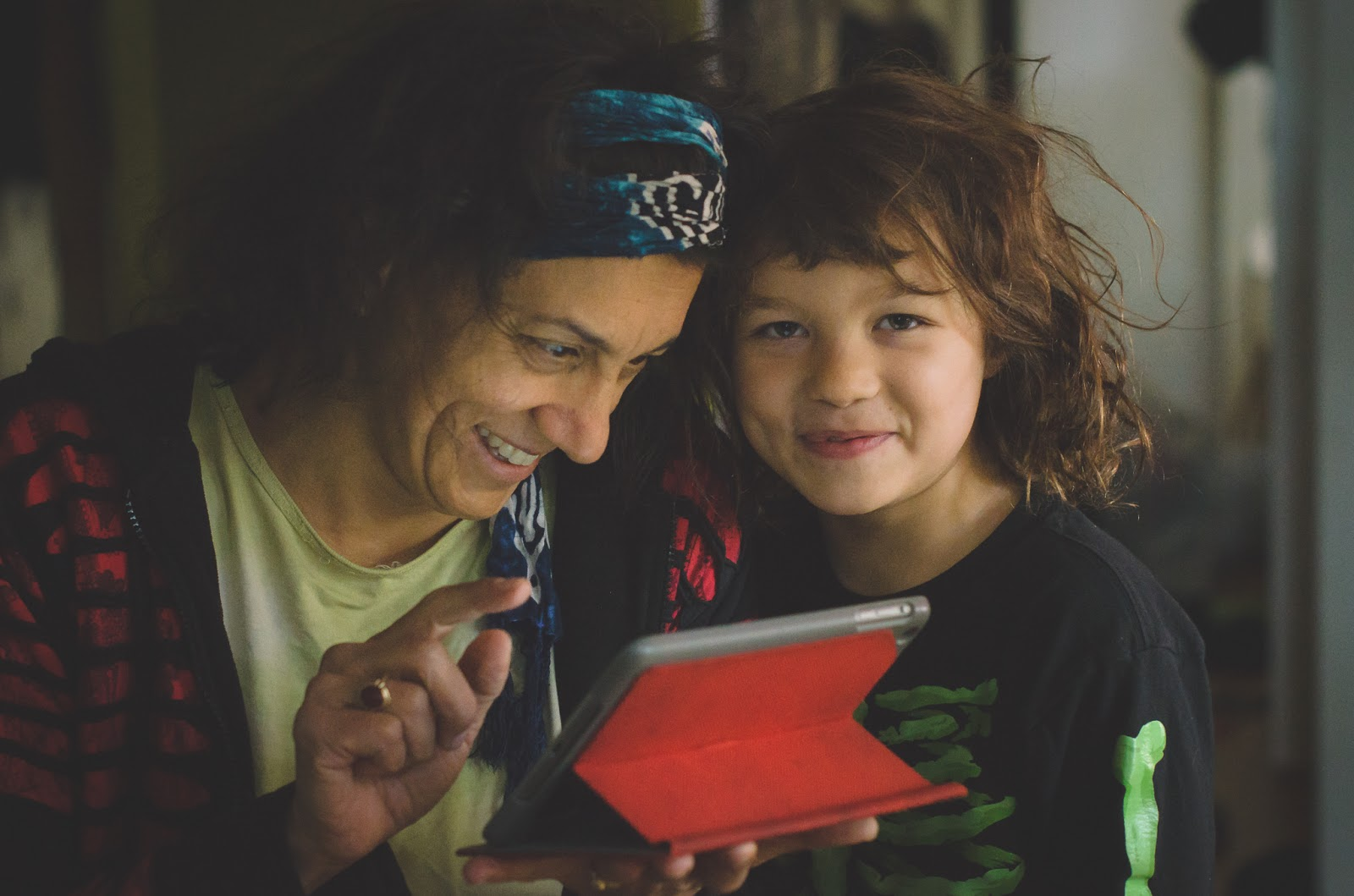 mother and son homeschooling looking at tablet ©Diana Sherblom Photography