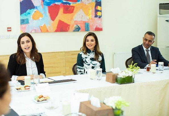 Queen Rania wore Manolo Blahnik BB 105 suede teal green shoes heels pumps. She carried Tod's mini bag. print green silk blouse
