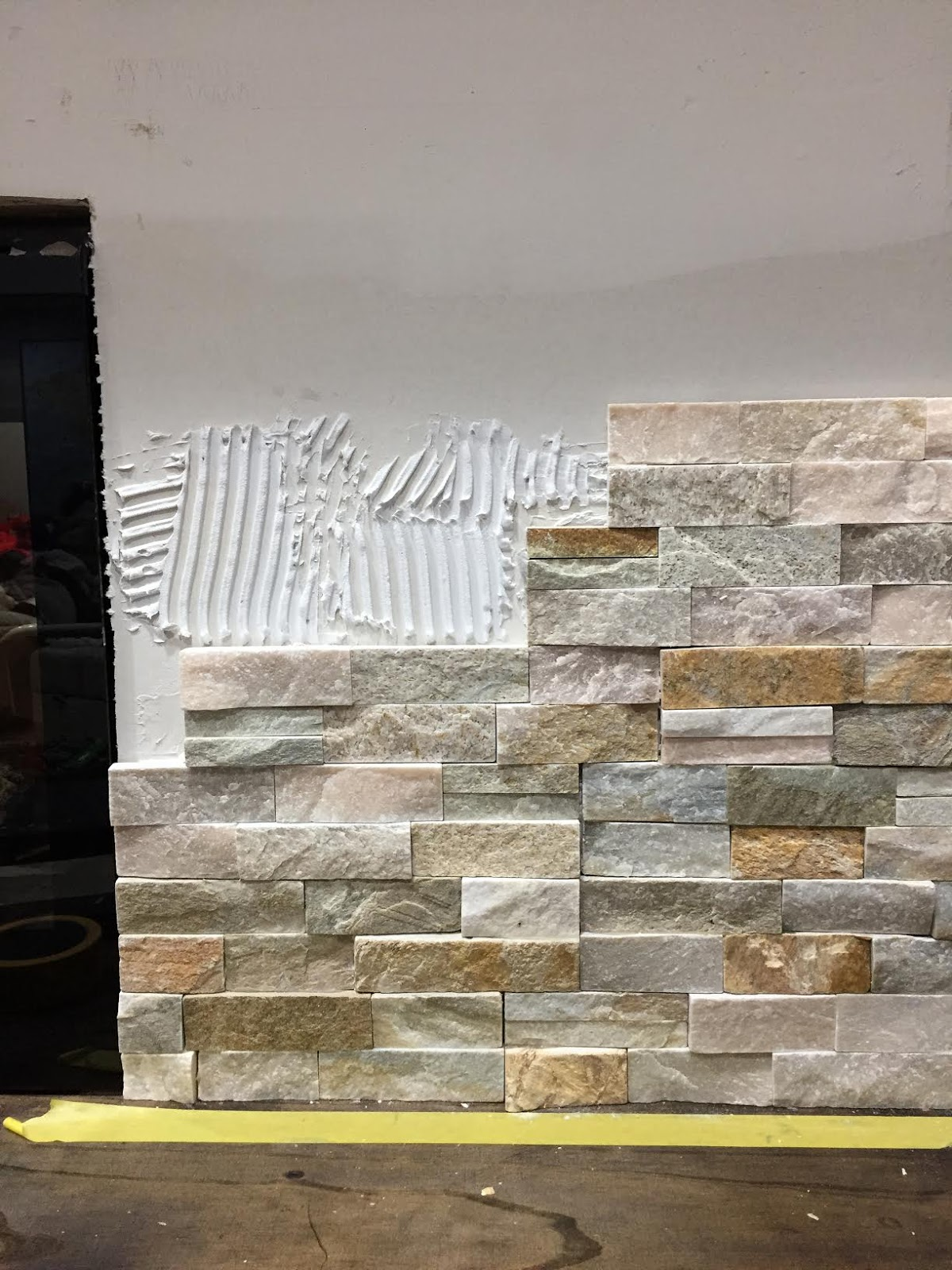 How to install stacked stone tile on a fireplace wall from Thrifty ...