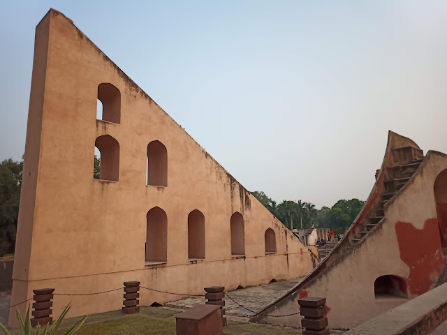 Tall triangular astronomical instrument with arched windows at Jantar Mantar, New Delhi
