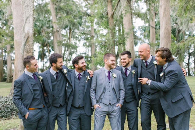 groomsmen with tux and purple ties