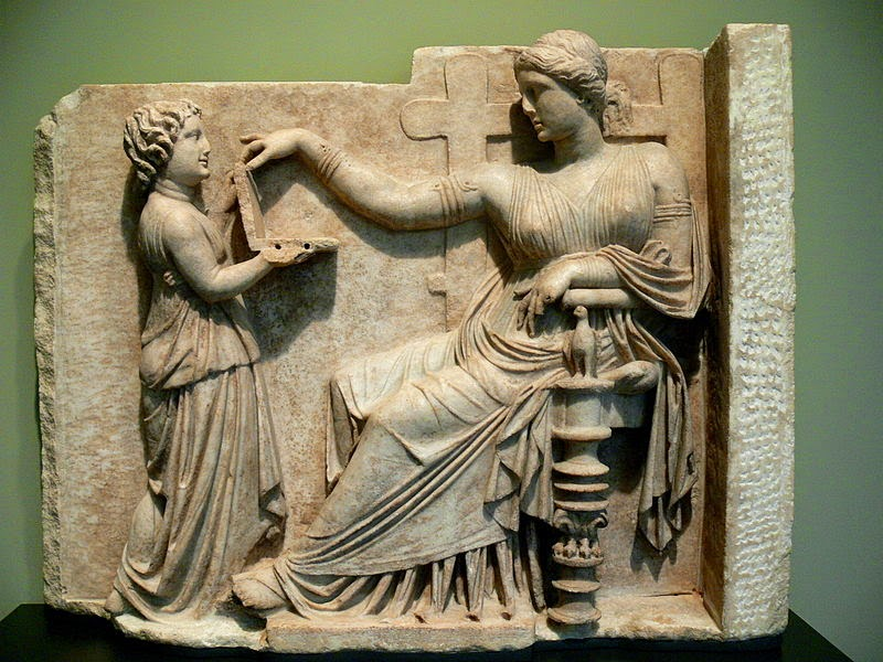 Ancient Gravestone Depicts A Woman Using A Laptop