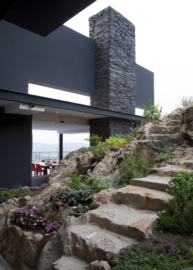 Picture of stone and flowers in the landscape by the house