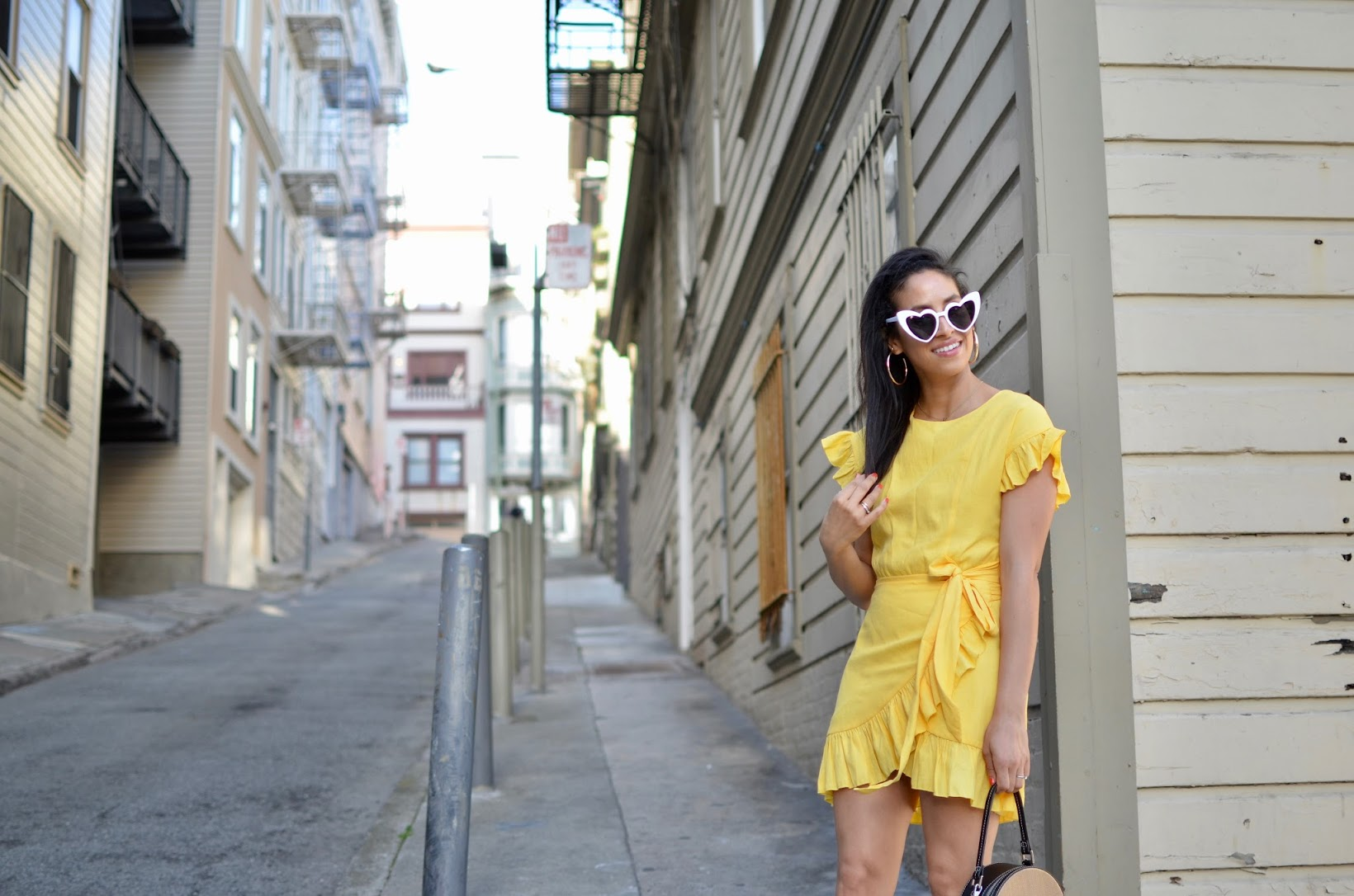yellow linen ruffle dress, heart cat eye sunglasses, thick gold hoop earrings, anine bing charlie boots, san francisco street style