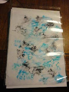 Blue and black ink in plastic folder ready to make backgrounds