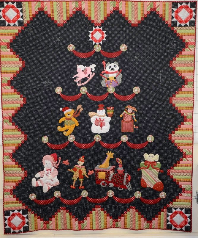 http://www.inbetweenstitches.com/shop/Patterns/p/Toyland-Tree-x2499231.htm