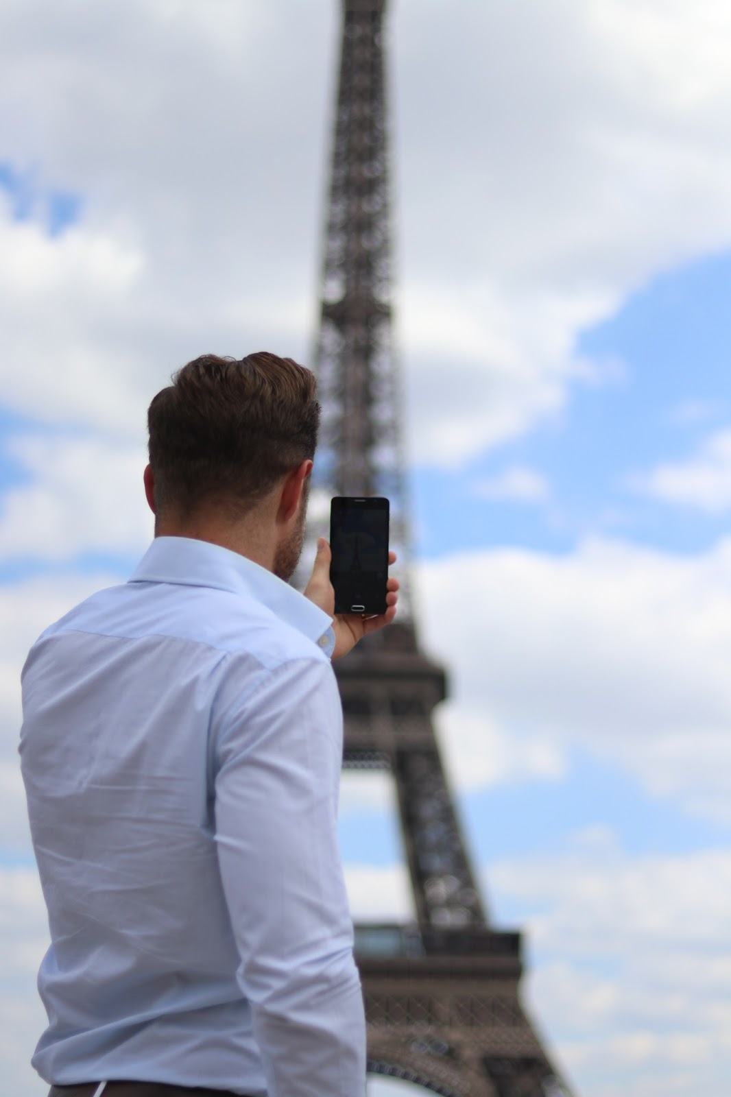 Ben Heath taking a photo of The Eiffel Tower, Paris, France