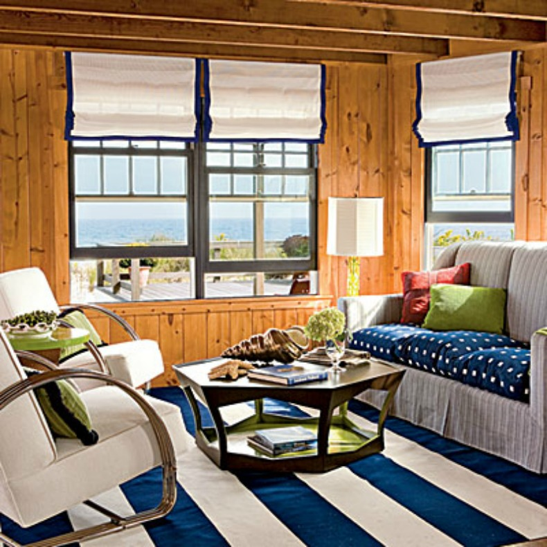 cozy cottage style blue and white living room with ocean view