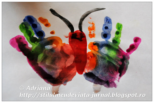 fluture pictat cu manutele