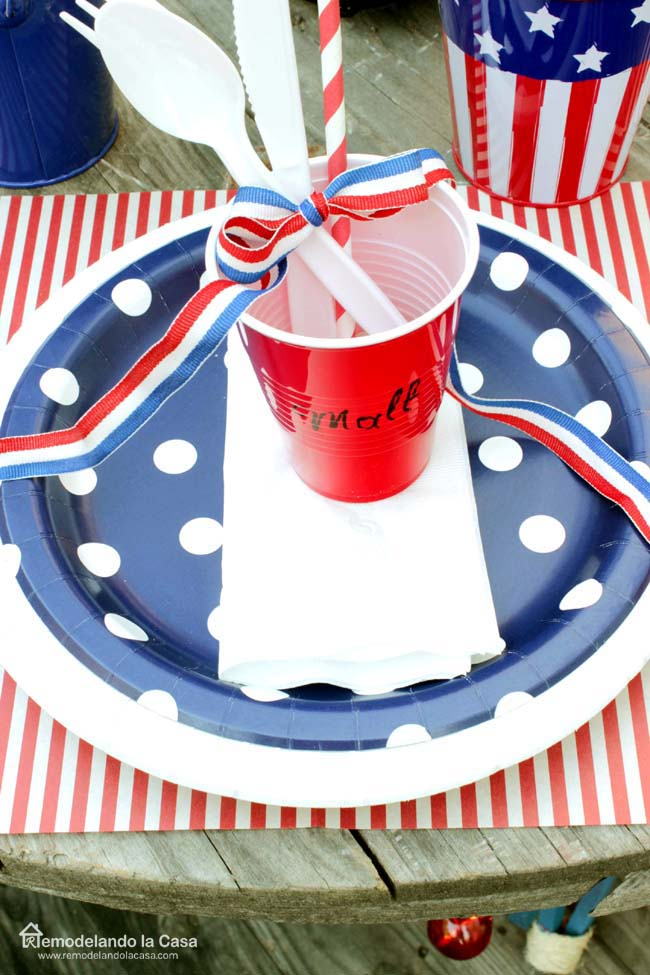 blue and white polka dot plates, red and white striped placemats, red cups