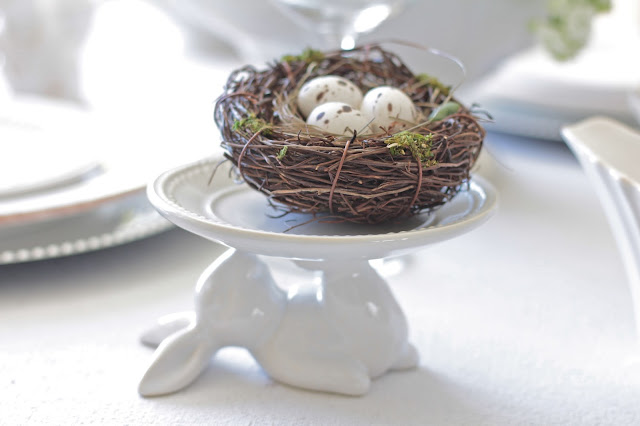 neutral easter tablescape nest eggs on bunny cupcake holder pottery barn