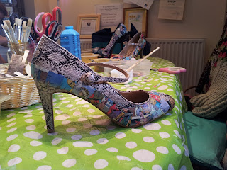 Shoe partially decorated with random pieces from a comic book
