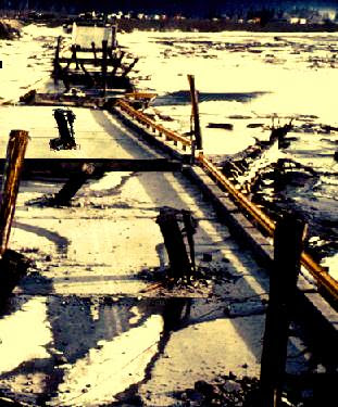 In Alaska Earthquake March 27, 1964, Twentymile River Bridge fell into the river, and some of the wood piles were driven through the reinforced concrete deck