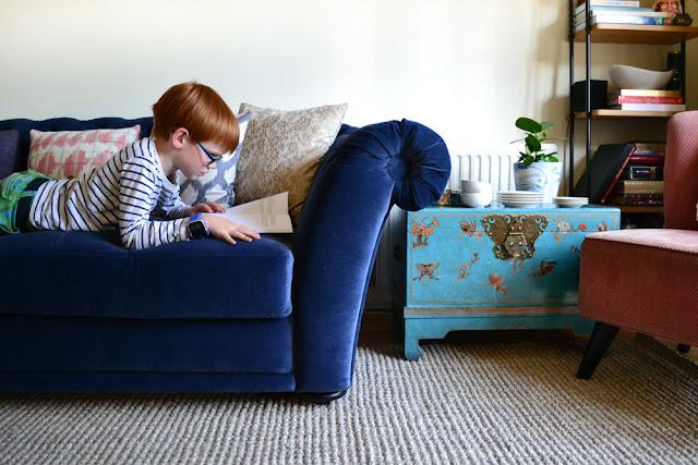 child reading on sofa