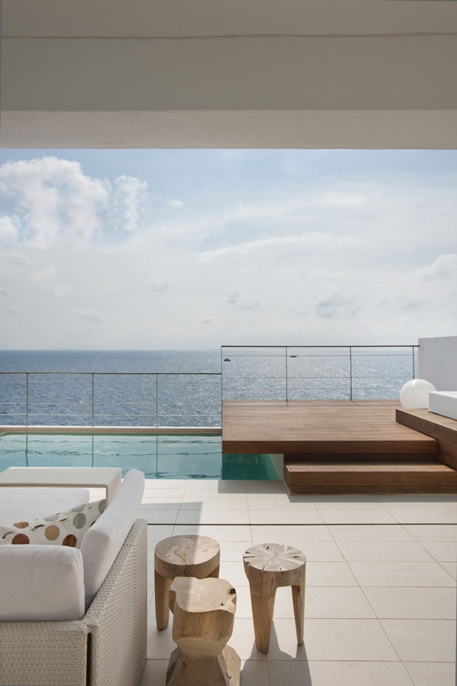 Terrace with outdoor furniture and swimming pool