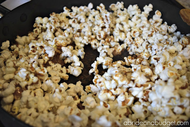 If you're looking for a tasty DIY wedding favor, go with this Bacon Caramel Popcorn Wedding Favor from www.abrideonabudget.com.