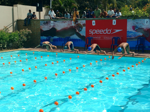 Children participating at the swimming competition