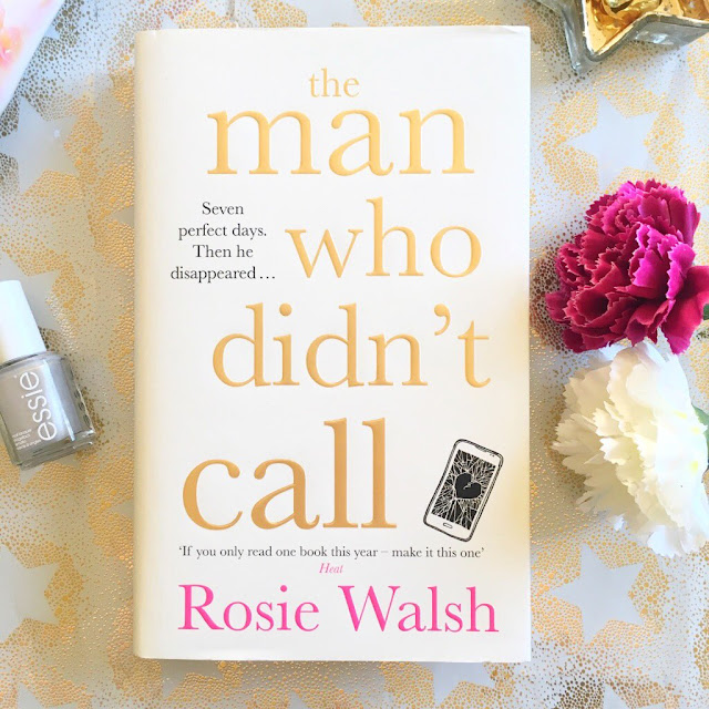 The Man Who Didn't Call by Rosie Walsh book in the centre. Flowers to the right side, Essie silver nail polish to the left side