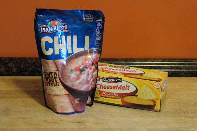 A picture of the Progresso chili in a bag and a box of processed cheese.