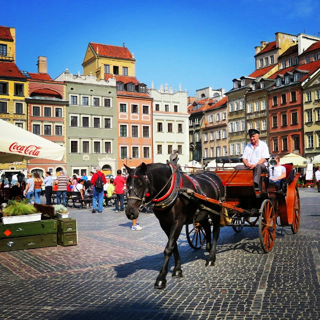 Horse and carriage passing through the Market Square in Old Town Warsaw