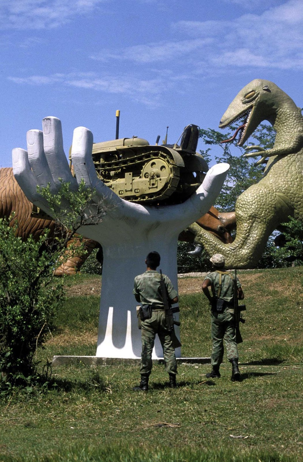 Soldiers inspect sculptures on the grounds of the hacienda.
