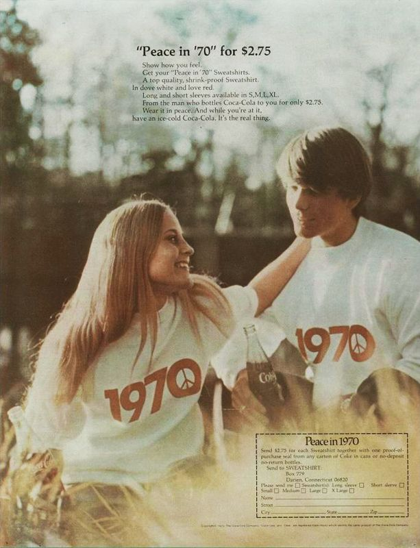 """Peace in '70"" Coca-Cola sweatshirt promo. A young couple outside, drinking coke while wearing peace sweatshirts"