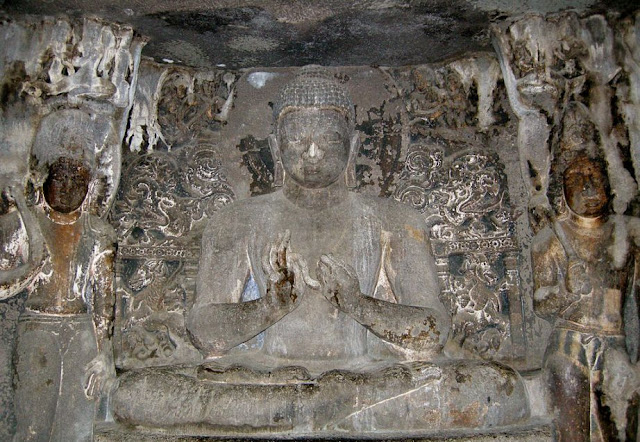Buddha in the uppercave 6 shrine - note padmapani and vajrapani on sides
