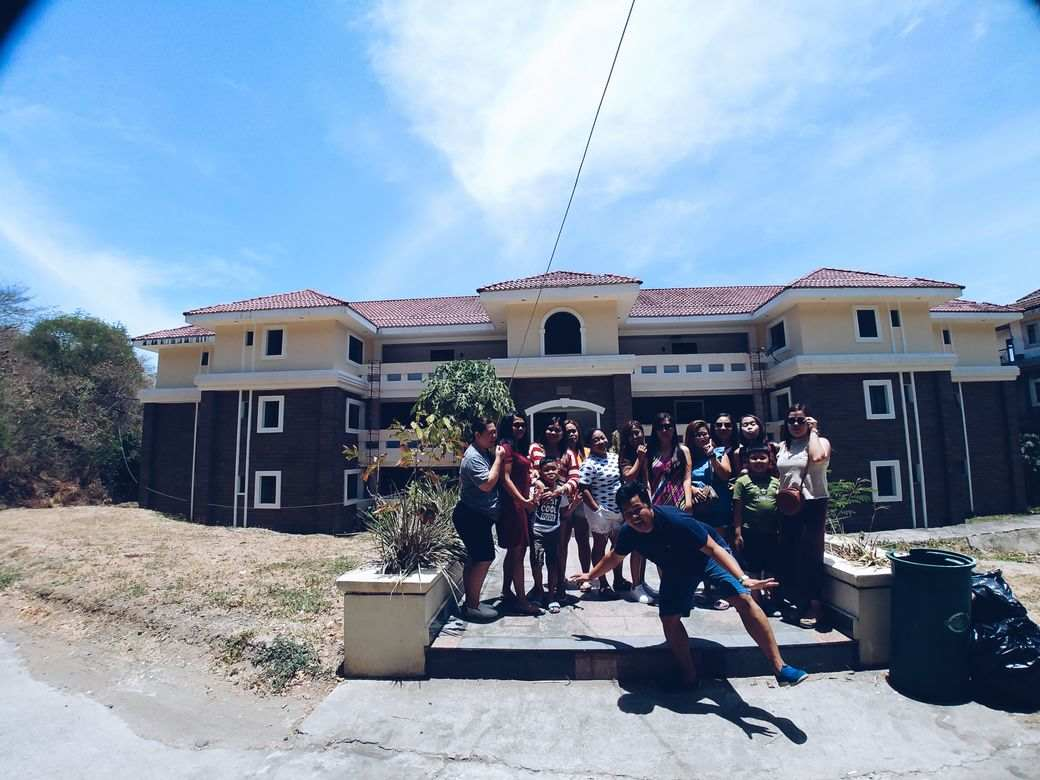 group photo at the facade of our unit at Canyon Cove