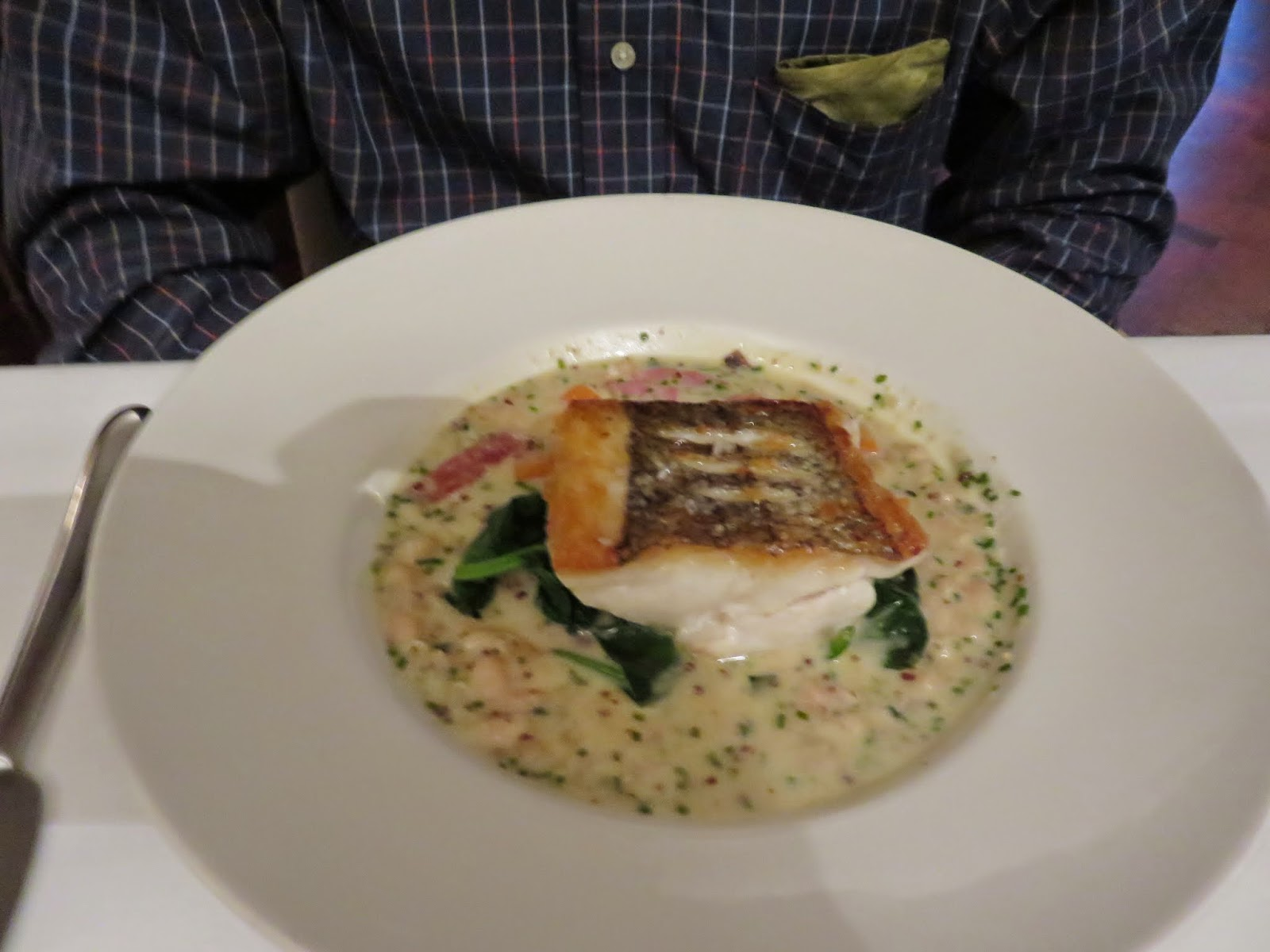 pan fried hake, haricot beans, baby spinach, salsify, and Morteau sausage
