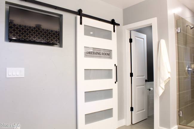 Closet barn door recessed tv