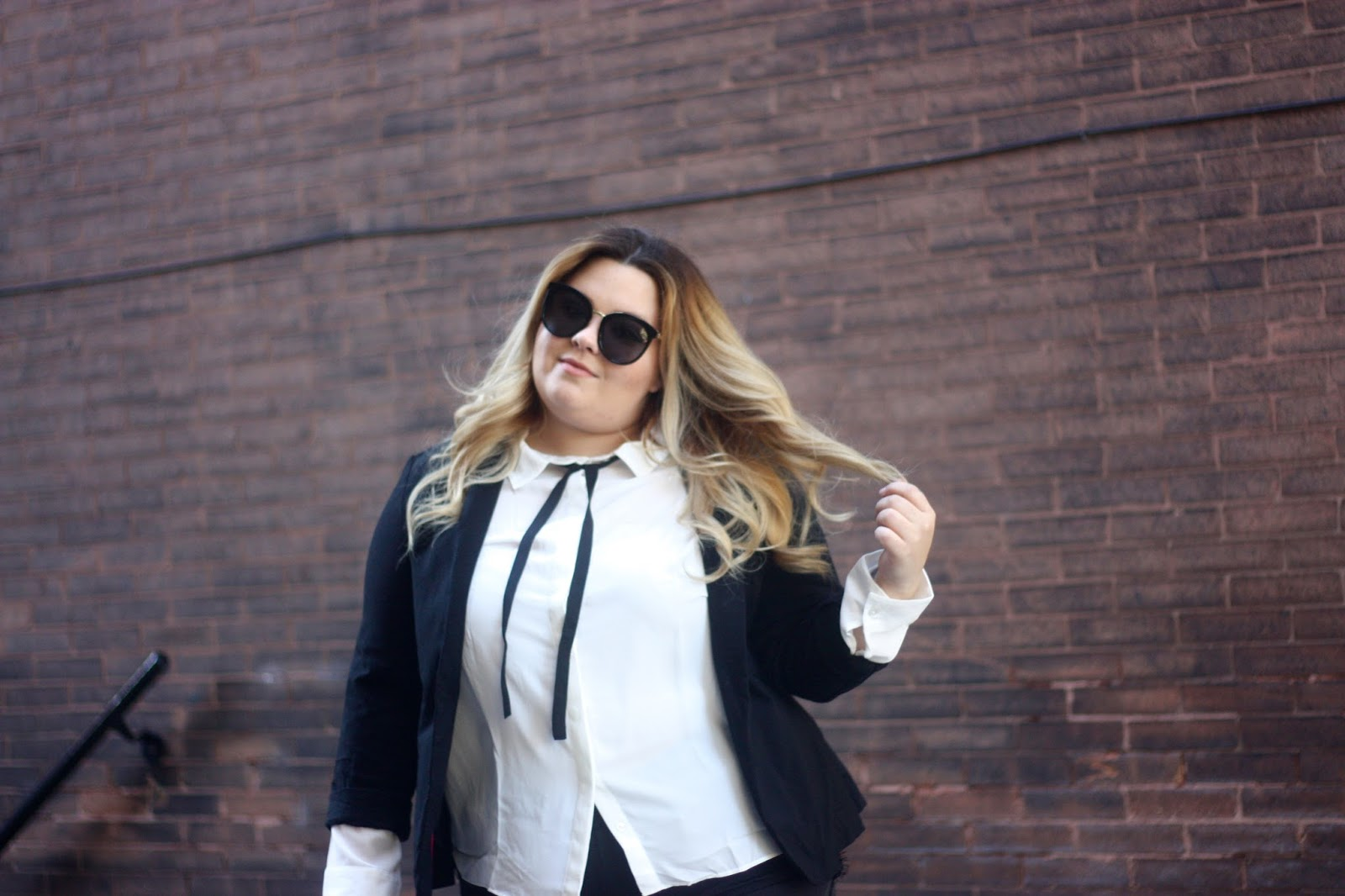natalie craig, natalie in the city, curvy girl fashion, bow tie blouse, suzy shier, canada fashion, plus size lace shorts, plus size fashion, chicago blogger, midwest blogger, natalieinthecoty.com, plus size blazer, open toed perforated booties, karl lagerfeld, college fashion week, fatshion