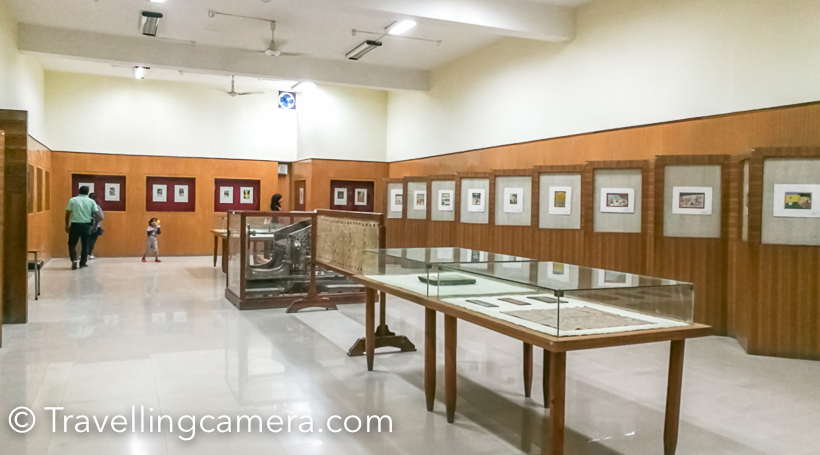 Chamba is popular town name in bollywood movies but not that popular on tourist map. Places like Dalhousie and Khajjiar around Chamba are quite popular. Very few tourists visit the town. Chamba is district headquarter in Himachal Pradesh and today we are going to share about Bhuri Singh museum, which shares a lot about the history of Chamba kingdom & other small kingdoms around this place. Also a glimpse of old art-forms from this part of the world.     Bhuri Singh Museum is located in the middle of the Chamba town. As you enter Chamba town and reach Chugan ground, take left to enter into Taxi parking. Park your car there and museum is at 5 minutes talk on same road.     One needs to buy entry ticket to the Museum, which is 20 rs per person and if you are carrying a camera, pay 50 rs extra. (These charges may vary over time)    The Museum is unique in it's own way. It makes to go back in history and imagine how people in these Kingdoms would have lived. How the houses looks, how they created sources of water, the importance of art at these sources of water etc. Above is a photograph of door with different kinds of paintings on each block.     There are various paintings created in last century depicting various things about religion, kingdoms and lifestyle. Some of these painting ask very hard and strong questions about the social norms followed at that time Of-course, most of these are open for interpretation, but some are subtly forcing you to ask some basic questions. Some of the are still true as of today.       Here is the photograph showing jewellery style popular amongst royal families of Chamba. I am sure there must be commonalities between various kingdoms in India and hence, you would have seen some of them earlier. Interestingly, some of these designs are still in use, but in relatively smaller sizes.     This room had carved stones collected from various villages of Chamba Kingdom. These stones were part of water sources in different villages. Imagine th