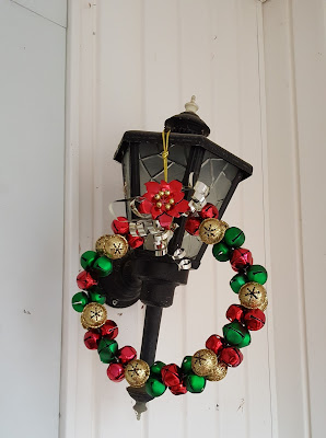 on a lamp, a wreath made of colored sleigh bells