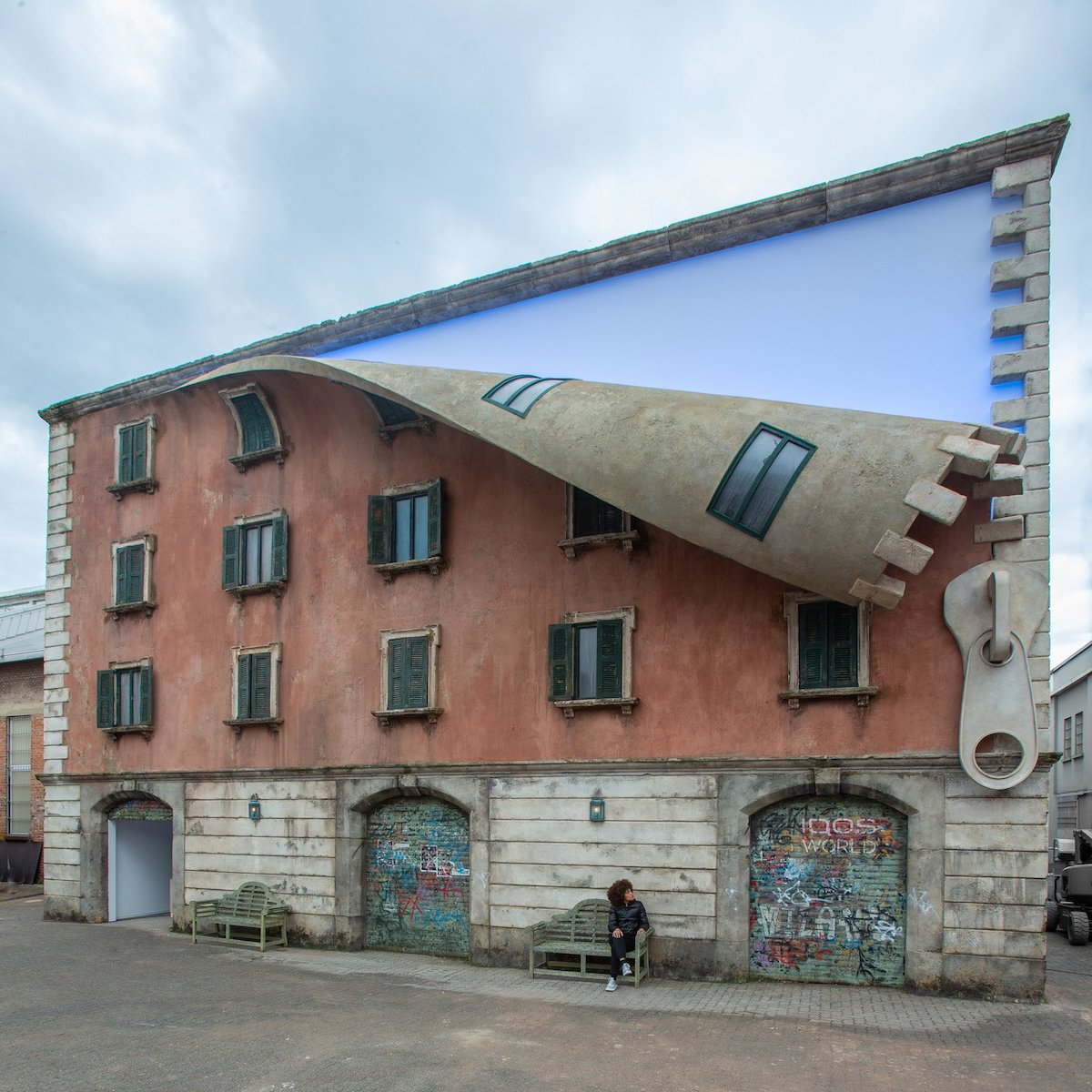 Sculptor 'Unzips' A Building In Milan With His Mind-Blowing Art Installation