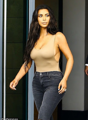 Photos: Kim Kardashian Puts Her Curves on Display in a Skintone Bodysuit