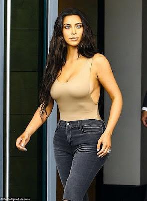 Photos: Kim Kardashian Puts Her Curves on Display in a Skintone Bodysuit