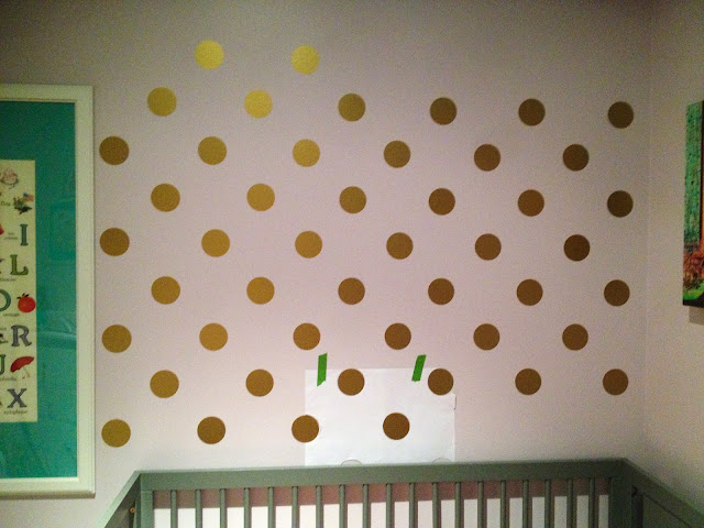 Applying wall decals using a DIY stencil