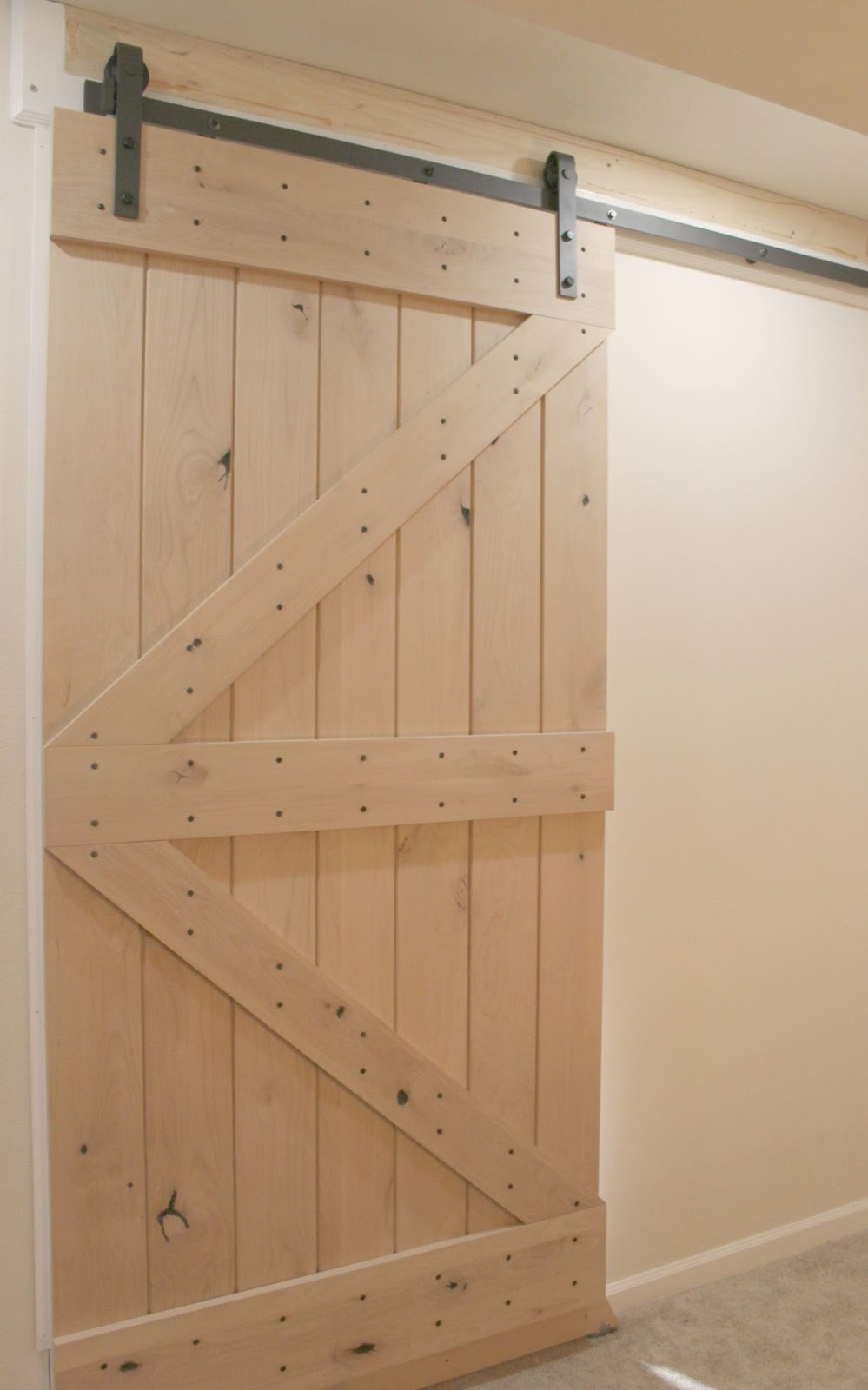 Pacific Entries rustic knotty alder barn door Hello Lovely Studio