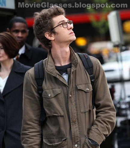 Andrew Garfield as Peter Parker walking through New York in The Amazing Spider-Man wearing Oliver Peoples Glasses